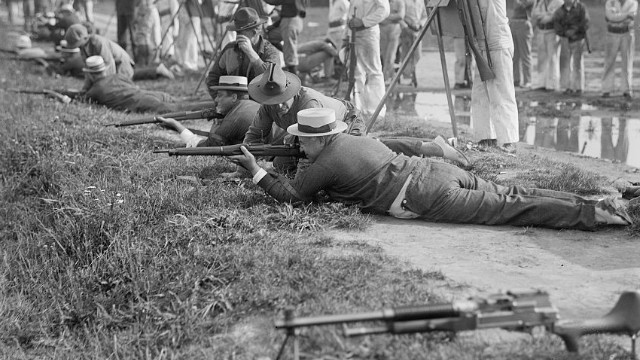 Franklin D. Roosevelt fires at the Marine Corps rifle range in Maryland in 1917.