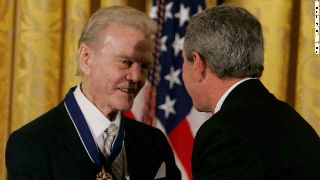 President George W. Bush presents Paul Harvey, left, with the Medal of Freedom at the White House November 9, 2005.