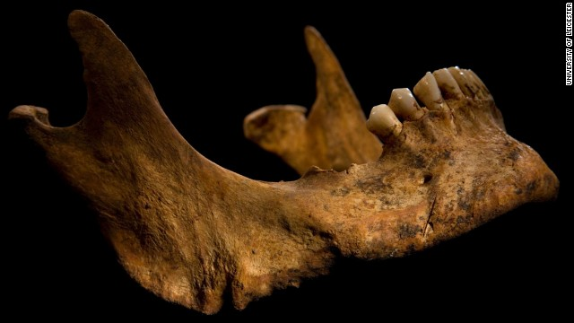 The lower jaw shows a cut mark caused by a knife or dagger.