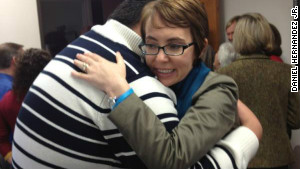 Gabby Giffords hugs Daniel Hernandez Jr. on the first anniversary of the Tucson shooting