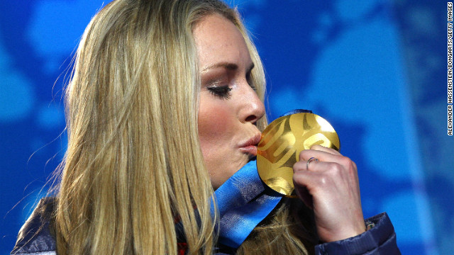 Vonn celebrates with her gold medal during the medal ceremony for the alpine skiing ladies downhill in the Vancouver 2010 Winter Olympics on February 17, 2010 in Whistler, Canada.