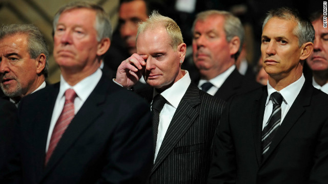 Paul Gascoigne wipes away a tear at the funeral of his former England boss Bobby Robson. Gary Lineker is on his left. 