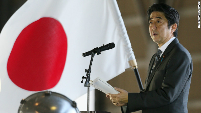 Japanese PM Shinzo Abe delivers a speech on February 2, 2013 on Okinawa near the disputed islands.