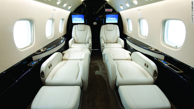 The Legacy 650 cabin includes a galley, high-speed broadband WiFi, Iridium satellite phone, iPod/iPhone docking systems, 32-inch HD LCD video monitor, Blu-ray disc players, front and rear lavatory and a 240 square-foot baggage compartment. Cabin height: 6 feet. Cabin length: 42.4 feet. Source: Embraer.