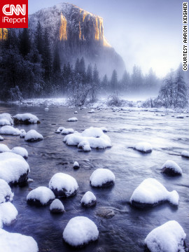 Snow and fog blanket Yosemite National Park in this stunning view from the Merced River.