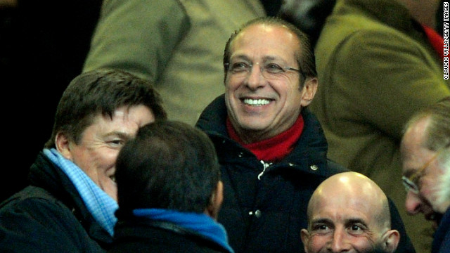 "Soon after Balotelli returned to Serie A, Berlusconi's brother Paolo -- during a political rally -- invited the public to an upcoming AC Milan match and was caught on camera -- the video was featured on the website of Italian newspaper La Repubblica -- saying: ""OK, we are all off to see the family's little black boy."" Paolo is pictured here, wearing glasses."