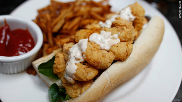 "Eat well and frequently with fare such as this shrimp po' boy at Muriel's. School yourself on ""<a href='http://eatocracy.cnn.com/2012/02/20/what-to-eat-drink-do-and-avoid-during-mardi-gras/'>What to eat, drink, do and avoid during Mardi Gras</a>."""