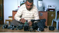 Co-director Emad Burnat with his five broken cameras