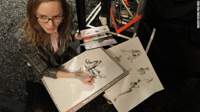 An artist sketches on the sidelines February 6 at the BCBG Max Azria show.