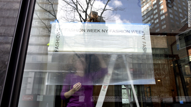 A store near the Lincoln Center hangs a Fashion Week sign in its window on February 4.