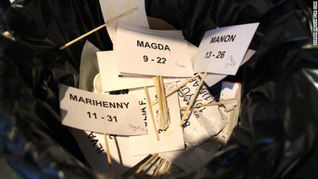 Discarded model name tags pile up in the trash after the Tadashi Shoji show on February 7.