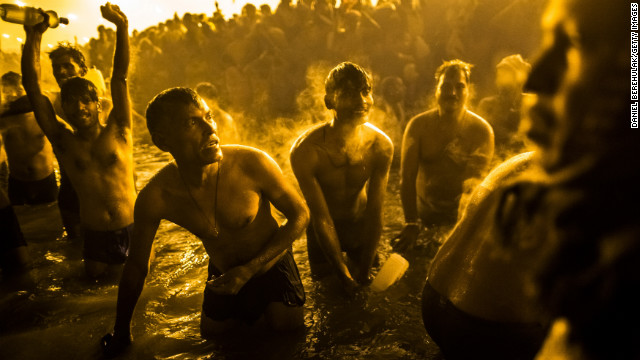 Devotees bathe in the waters of the Ganges.