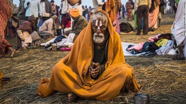 A Sadhu prays as he sits on the banks of Sangam.