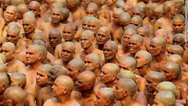 Newly initiated Naga Sadhus, translated &quot;naked holy men,&quot; prepare to perform rituals on the banks of the Ganges River on February 6. The men wear little to no clothing during the rituals, which include running into the river to bathe.