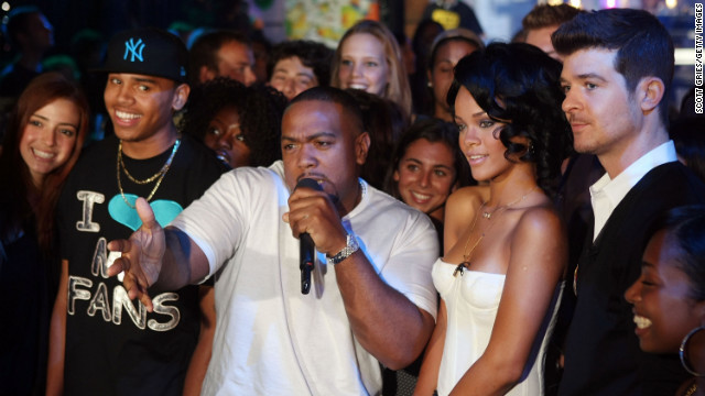 "In August 2007, Brown and Rihanna joined Timbaland, center, and Robin Thicke onstage during MTV's ""Total Request Live"" in New York"