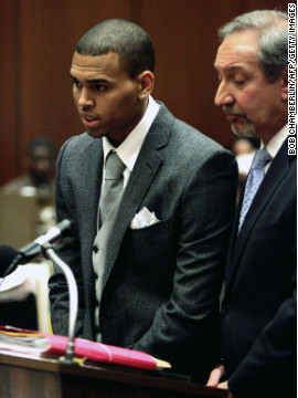 "Brown stood beside his lawyer, Mark Geragos, at court in Los Angeles in March 2009. Brown was charged with assaulting Rihanna on February 8. ""I'm in shock, because, first of all, that's not who I am as a person, and that's not who I promise I want to be,"" <a href='http://www.cnn.com/2009/SHOWBIZ/Music/08/31/chris.brown.interview/index.html' target='_blank'>Brown told Larry King in August 2009.</a>"