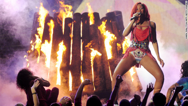 "Rihanna performs onstage during the 2011 Grammy Awards. In February, Schnegg <a href='http://www.cnn.com/2011/SHOWBIZ/celebrity.news.gossip/02/22/chris.brown.hearing/index.html'>lifted the ""stay away"" order</a> imposed on Brown."