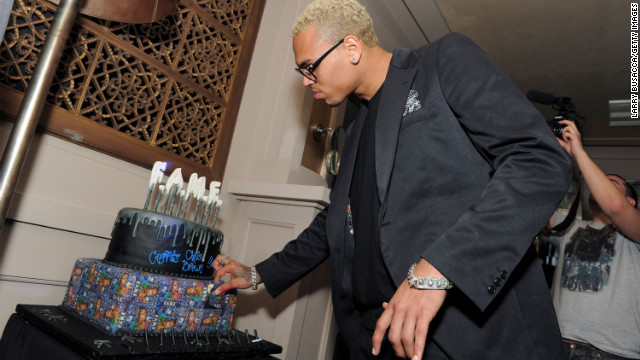 "Brown with a cake at a party in New York honoring the March 2011 release of his ""F.A.M.E."" album."