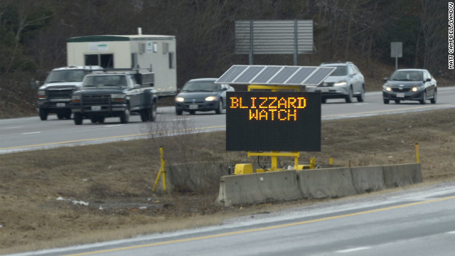 A sign warns drivers along Interstate 495 of a blizzard watch in Franklin, Massachusetts, on Thursday, February 7. 