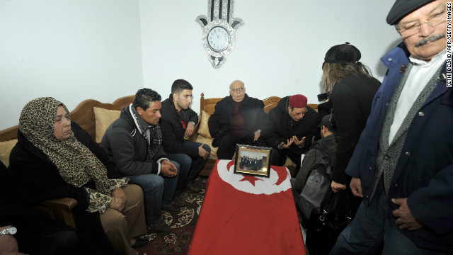 Family members and supporters mourn on February 7, 2013 around the of coffin of Chokri Belaid, an outspoken opposition leader who was assassinated the previous day, at his family home in the Tunisian capital's suburb of Jebel Jelloud.