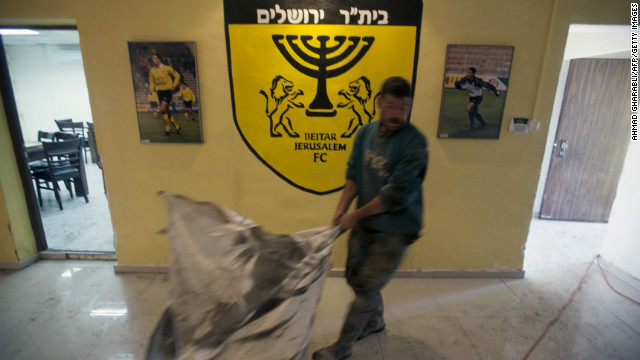 Israeli football club torched after signing Muslim players
