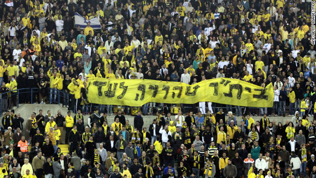 Beitar Jerusalem fans display a banner reading &quot;Beitar -- pure forever&quot; at a match on January 26 after their signing of two Muslim players.