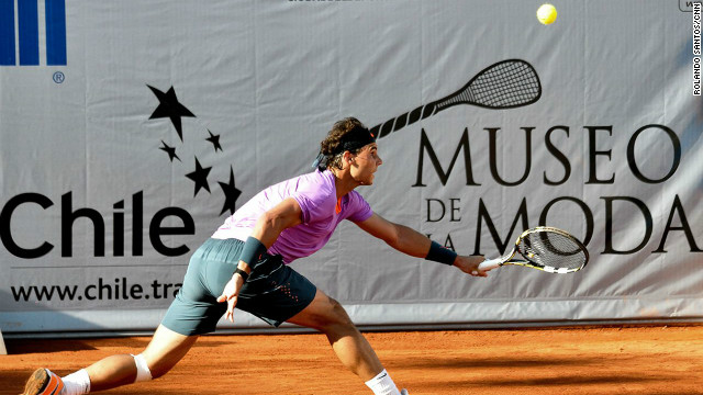 "About a half an hour into the match, Nadal chased a ball sideways across the court and slid on the clay surface but kept his balance. The look on his face as he came to a stop was a five-second blur of emotions. He looked wide-eyed at his knee as if expecting pain or a problem, before a trace of a smile crossed his face. He turned towards his opponent, his body language signaling ""game on."""