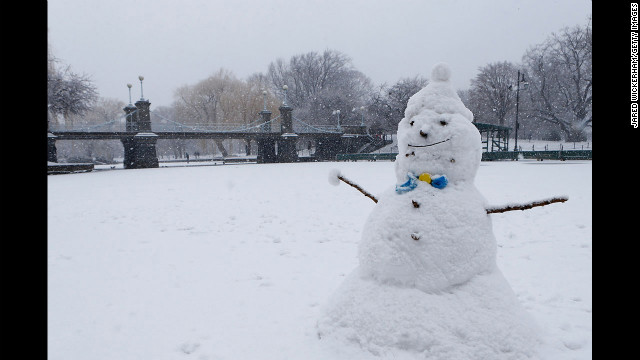 A snowman sits on the duck pond in the Boston Common.
