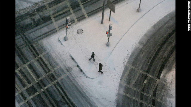 People walk through the snow in Boston's Back Bay neighborhood on Friday.
