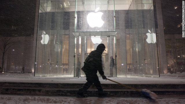 A man shovels snow in front of the Apple store in New York on February 8.
