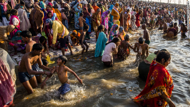 Hindu devotees bathe on the banks of the Sangam on February 9.