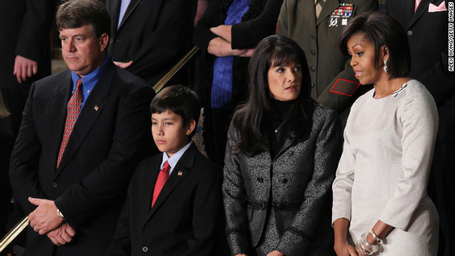 Left right, John, Dallas and Roxanna Green, family of the late Christina Taylor Green -- killed in Tucson by the gunman who shot then-Rep. Gabby Giffords -- were Obama's guests at the 2011 SOTU.