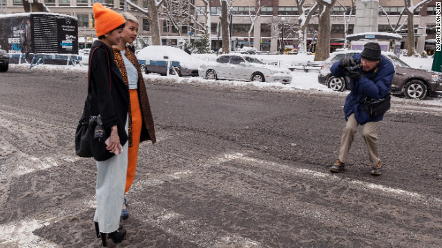 Well-dressed visitors to Fashion Week are photographed by legendary fashion photographer Bill Cunningham on February 9.