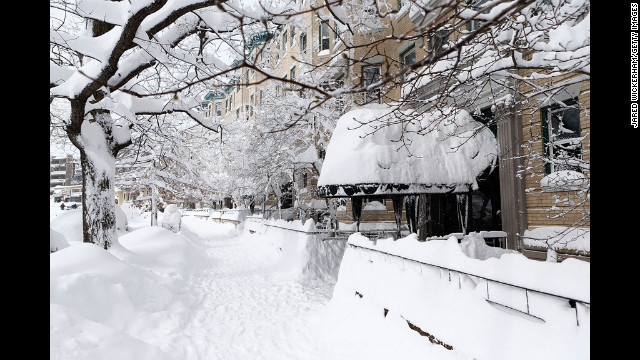 Snow covers a sidewalk and building awning in Boston on Saturday.