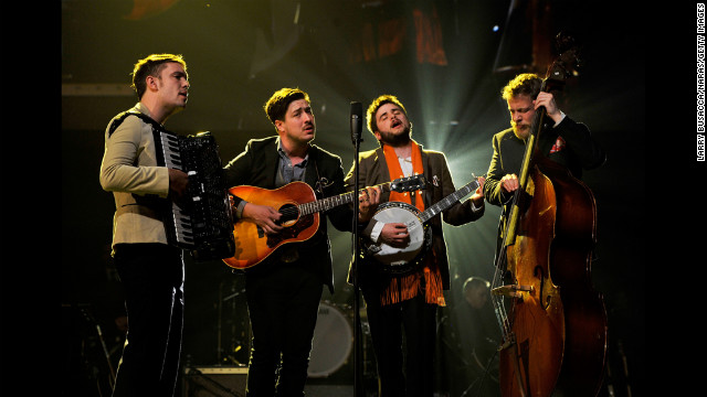 "Left to right: Musicians Ben Lovett, Marcus Mumford, ""Country"" Winston Marshall and Ted Dwane of Mumford & Sons perform ""I'm on Fire."""
