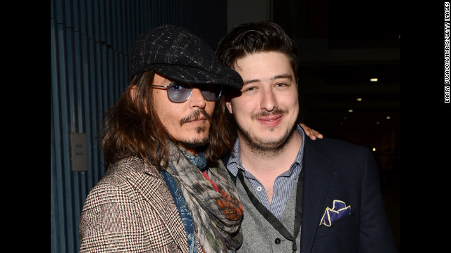 Actor Johnny Depp and Marcus Mumford of Mumford &amp;amp; Sons attend the Musicares gala.