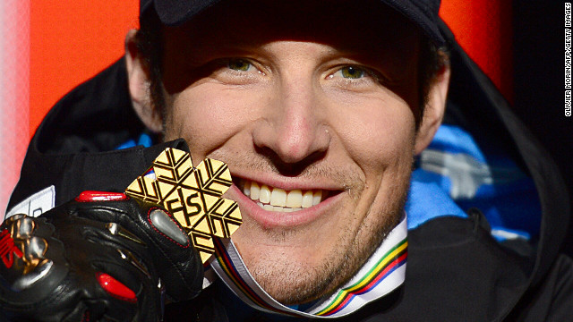 Svindal makes skiing history with downhill gold