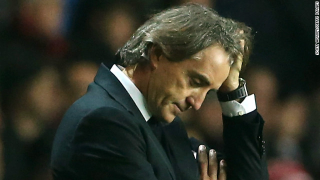 English Premier League leaders United are in pole position to reclaim the title from Manchester City, whose manager Roberto Mancini was furious with his players after a 3-1 defeat at Southampton.