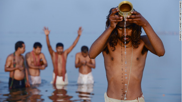 Hindu devotees pray as they bathe in the Sangam -- the confluence of the Yamuna, Ganges and mythical Saraswati rivers -- at the Kumbh Mela in Allahabad, India, on Sunday, February 10.