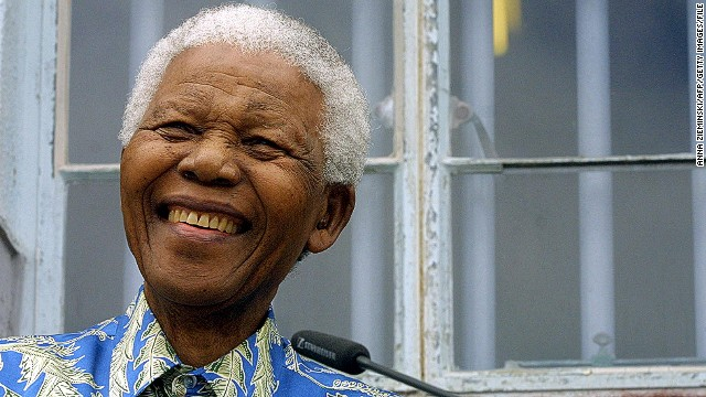 Former South African President Nelson Mandela struggled against apartheid for much his life. Here he is shown in 2003, speaking in front of his former prison cell on Robben Island. Mandela was imprisoned in 1963 and released on February 11, 1990.
