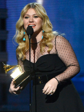 "Kelly Clarkson won best pop vocal album for ""Stronger."" ""I get nervous speaking in front of people,"" she said accepting her Grammy. ""Miguel, I don't know who the hell you are, but we need to sing together."" This is Clarkson's third Grammy."
