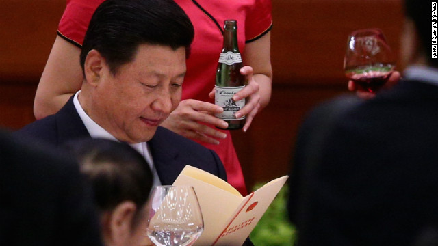 New Chinese leader Xi Xinping (C) has warned the country's leadership to scale back ostentatious behavior.