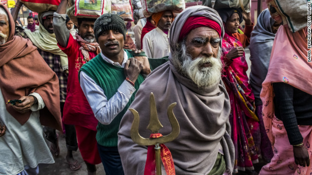 Hindu devotees walk towards Allahabad train station as people arrive and depart from the Maha Kumbh Mela.