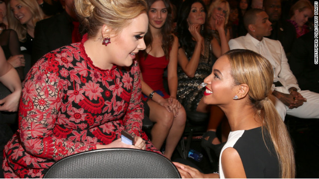 "Beyonce: ""Do you see that girl in the red trying to photobomb us right now?!""<!-- --> </br>Adele: ""Bey, I do! Just ignore her and smile."""