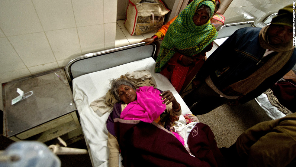 Bittan, 55, lies on a bed at the Railway Hospital in Allahabad after being injured in a stampede at the main railway station.