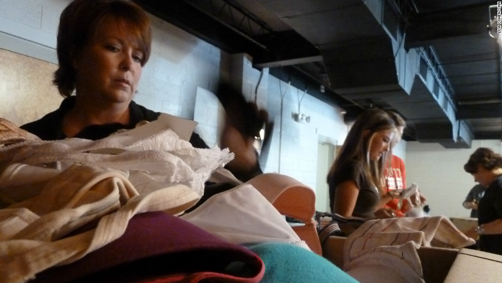 Kimba Langas, left, packs bras in Denver, Colorado, destined to help rescued sex slaves in Mozambique.