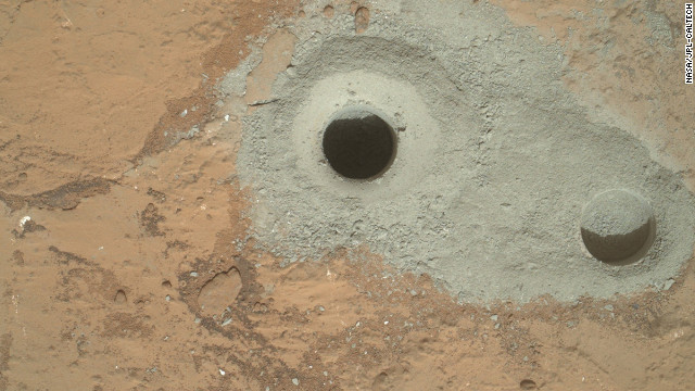 "The rover drilled this hole, in a rock that's part of a flat outcrop researchers named ""John Klein,"" during its first sample drilling on Mars on February 8."