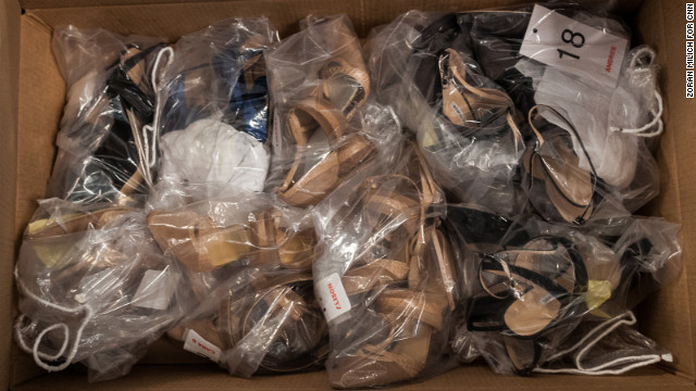 A wealth of shoes accumulate in a box backstage at the Carolina Herrera show on February 11.