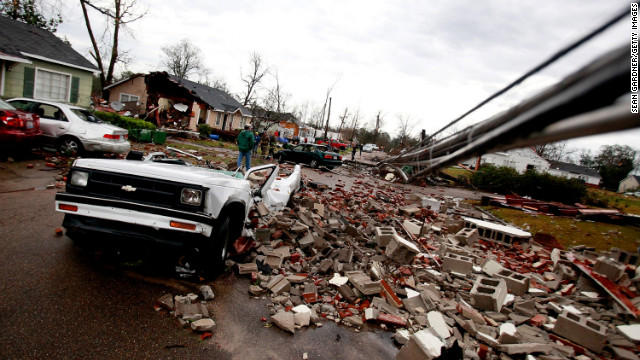 A crushed car sits amid the debris in Hattiesburg on February 11.