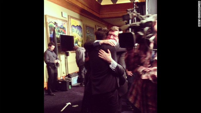 "Marcus Mumford and his proud father, John, share a heart-meltingly sweet bear hug backstage after Mumford & Sons' ""Babel"" won album of the year."